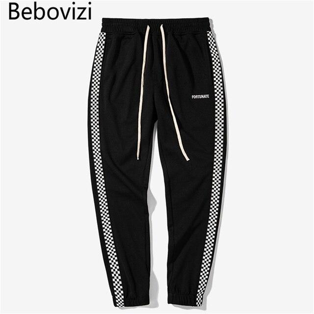 4 Color 2018 otoño nuevo ajedrez rayas costura mujeres hombres cintura  elástica Pantalones hip hop casual 8d486e34b74