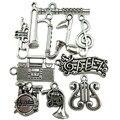 Free shipping 10PCS MIX Silver Music Note Saxophone Radio Harp Flute Drum Trumpet Band Pendant