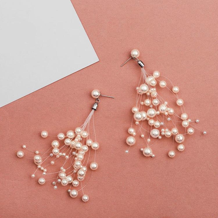 Simple temperament design pearl round buckle long earrings retro personality handmade earrings