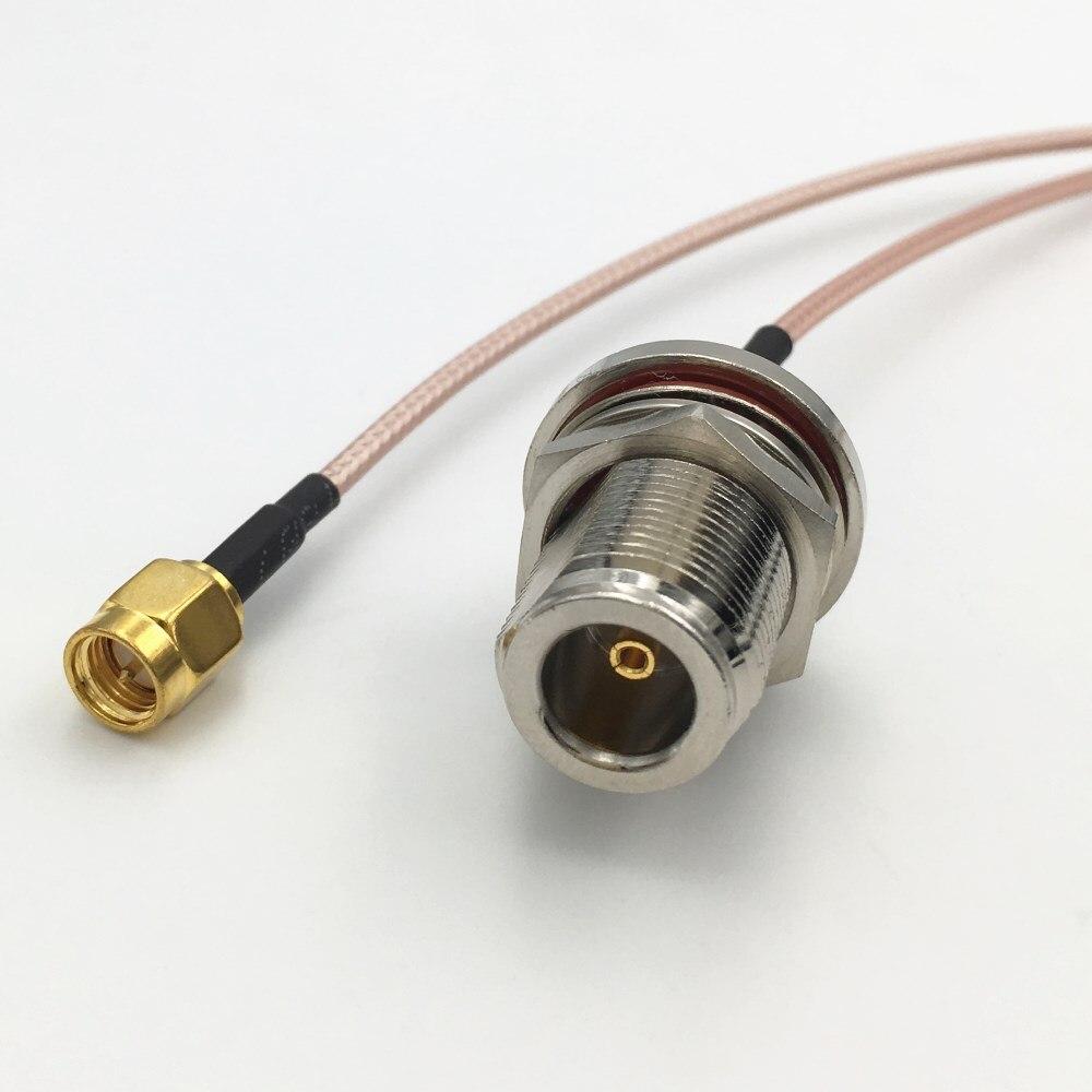 N femelle cloison à SMA mâle angle droit à sertir RG316 cable pigtail 15 cm