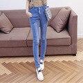 En la primavera de 2016 nueva mujer de talle alto vaqueros pantalones lápiz pies pantalones elásticos larga fila fábrica directa