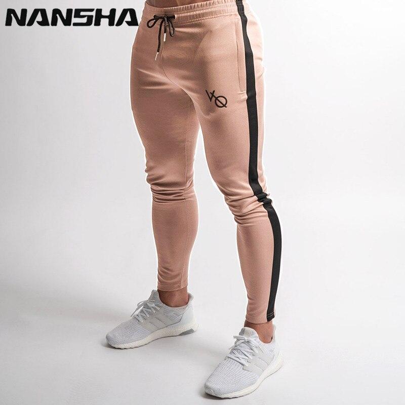 NANSHA 2018 NOVOS GINÁSIOS Mens Basculadores Sweatpants Corredores Calças de Fitness Moda Casual Marca Inferior Snapback Calças Dos Homens Calça Casual