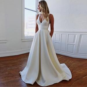 Image 1 - Cổ Chữ V Đơn Giản Áo Váy Cut Out Nơ Lưng Áo Bao Phủ Nút Trắng Ngà Gợi Cảm Bãi Biển Áo Cưới Đầm Vestido De noiva