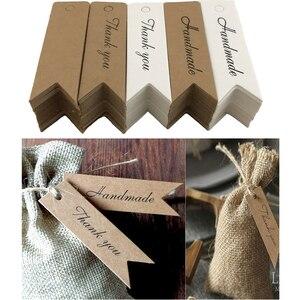 Image 1 - 100Pcs Kraft Papier Ornament Label Prijs Tags Wedding Christmas Party Favor Gift Card Goederen Bagage Tags Verpakking Labels