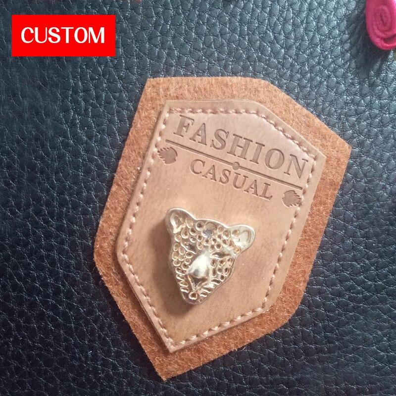 Étiquettes en relief de logo en métal en cuir d'unité centrale personnalisées par usine cousant sur des vêtements étiquettes personnalisées en cuir véritable d'habillement