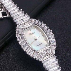 Image 1 - نساء السيدات بلينغ الماس كريستال حزام ساعة موضة فاخرة الفولاذ المقاوم للصدأ التناظرية الكوارتز ساعات المعصم هدية relogio feminino