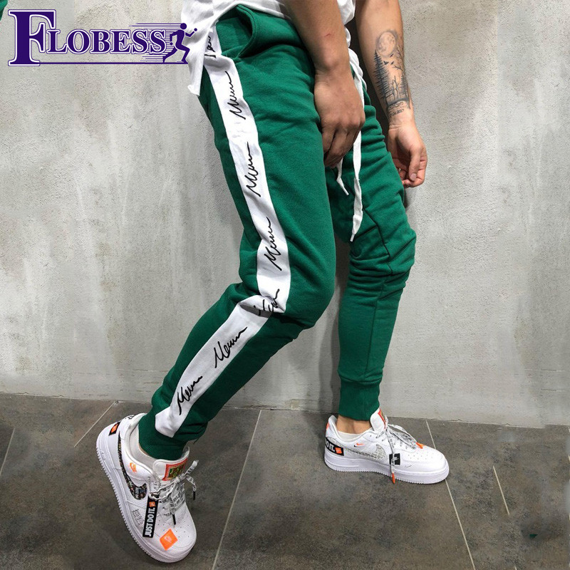 все цены на Men Letter Print Jogger Sports Pants New 2018 Male Leisure Fitness Running Skinny Long Trousers Mens Striped Pencil Pants