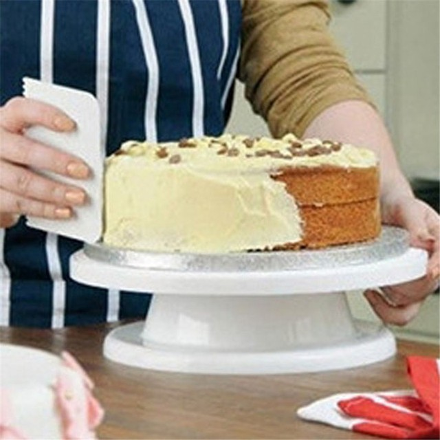 Torta torta di Base Della Torta Che Decora Gli Attrezzi di Rotazione Del Basamen