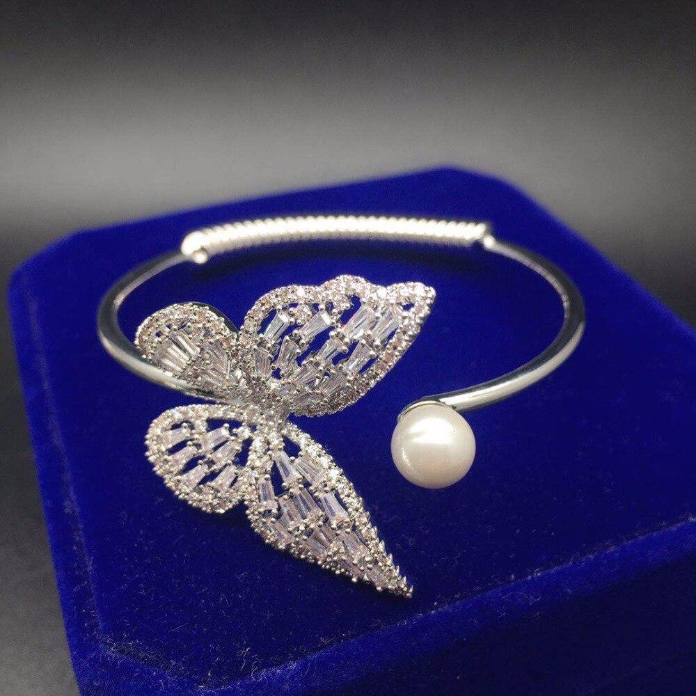 Base en cuivre AAA cubique zircone pierre forme papillon perle manchette ouverte taille réglable bracelet à main pour les femmes