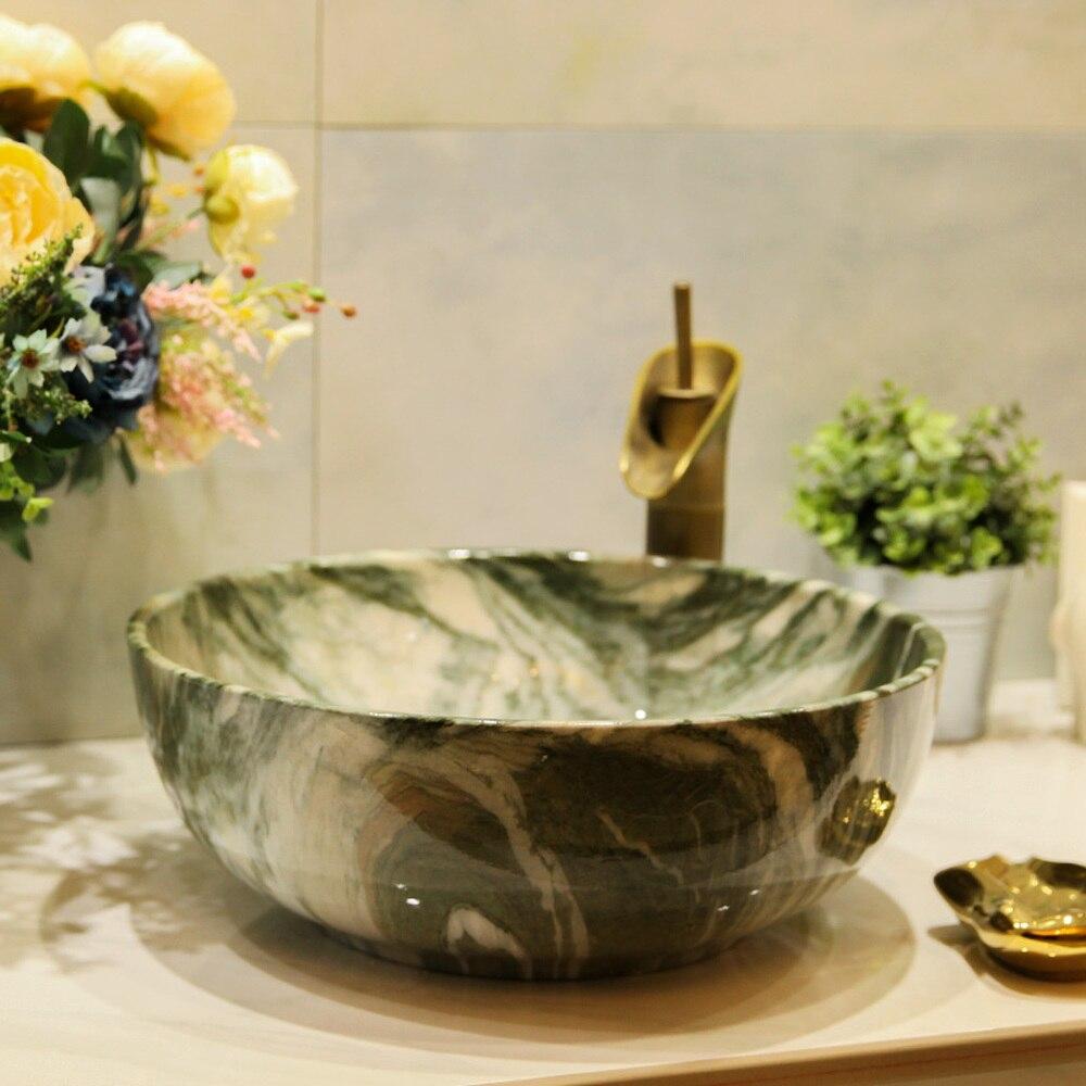 Lavabo rond chinois en céramique au-dessus du comptoir lavabo lavabo art bassin marbre texture LO621340