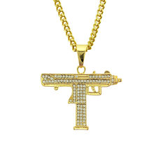 and the United States hip-hop fashion uzi golden gun pendant necklace man sautoir alloy rhinestone ablaze the guns(China)