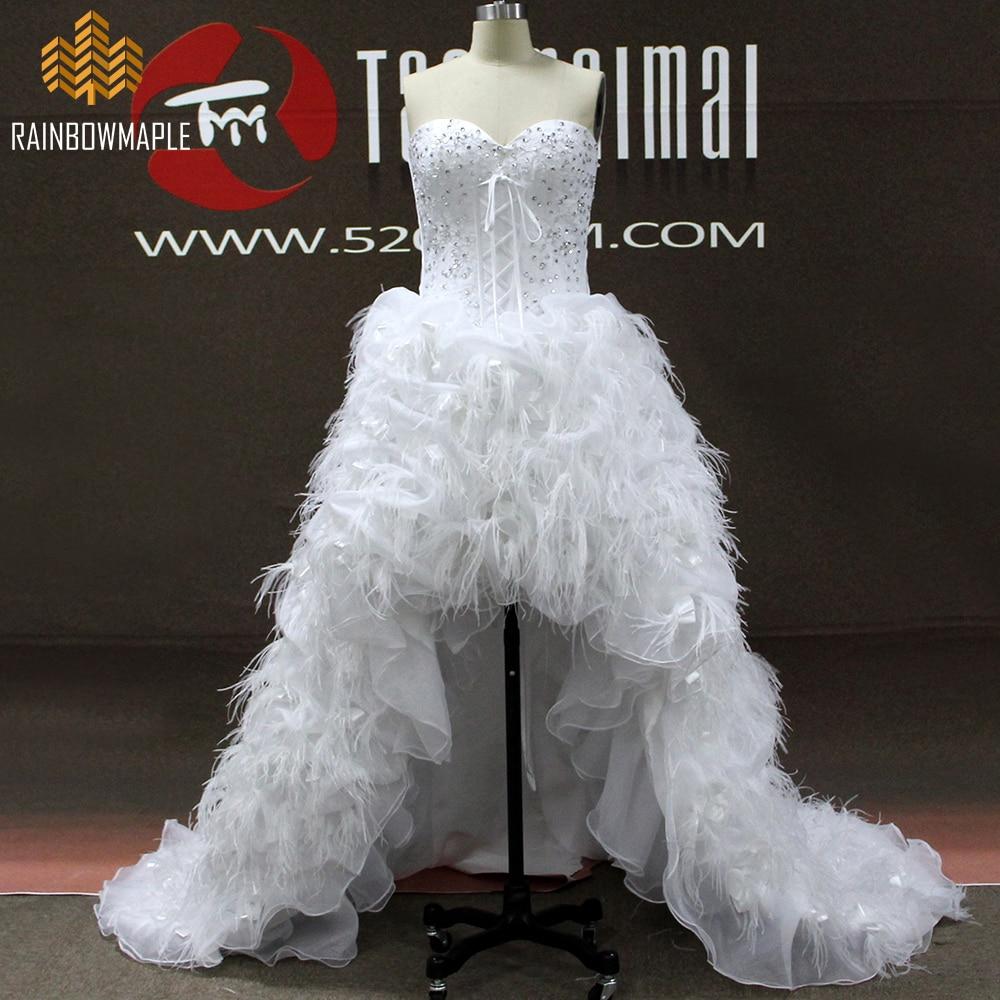 Robe de mariee dentelle et plume