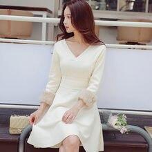 67a50662be Dabuwawa mujeres elegante con cuello en V vestido de invierno nueva moda  Casual botón Beige rodilla-longitud punto Midi vestido .