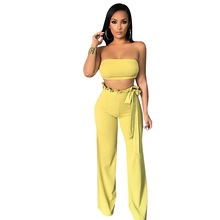 купить 2019 Fashion Women Solid Strapless Lace Up Sexy Two Piece Set Ruffles Crop Top And Wide Leg Pants Party 2 Piece Set по цене 1053.82 рублей