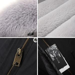 Image 5 - MAOMAOKONG abrigo de invierno de manga larga para mujer, abrigos de exterior holgados de gran tamaño de mongolia Natural, Cuello de piel de oveja, Parka larga, chaqueta de mujer