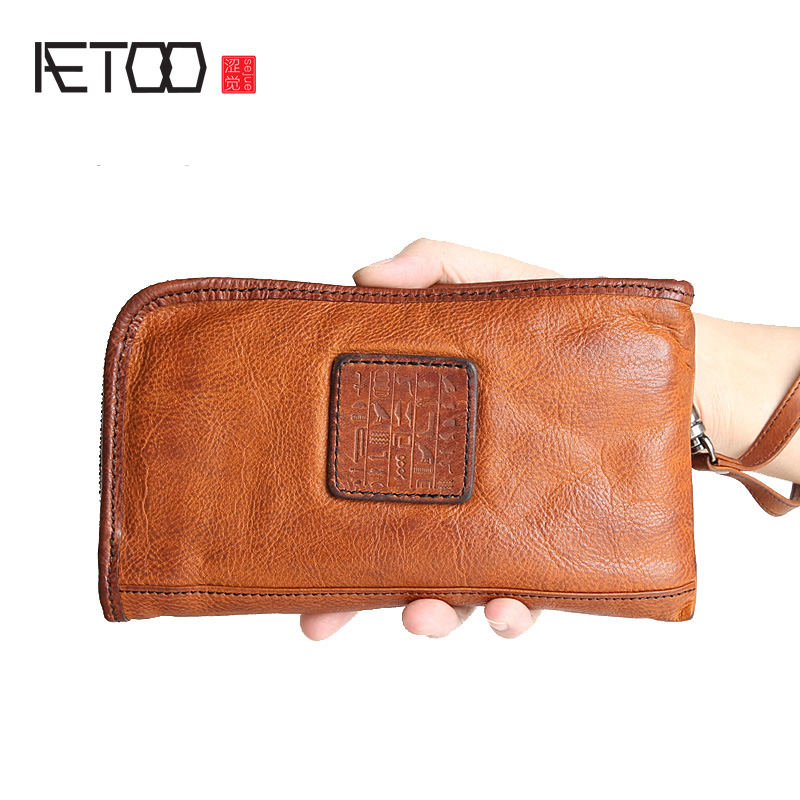 AETOO Men 's long wallet is the brand of the first layer of leather hand bag leather zipper handbag large - capacity Vintage 2017 hot high quality brand baotou layer of cow leather bags the new ms tassel handbag is a 100% leather handbag