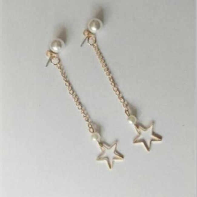 Personnalité minimaliste géométrique élément creux coeur pentagramme croix femelle perle boucles d'oreilles européennes exagérées longues boucles d'oreilles