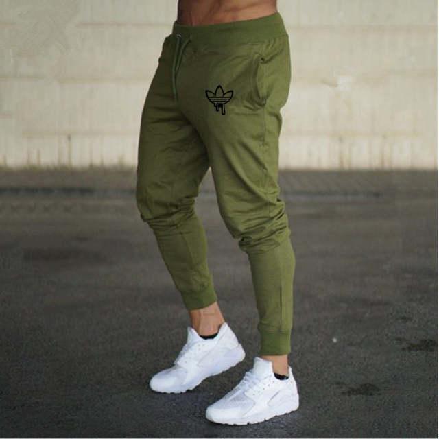 compras nueva llegada elegir oficial 2018 hombres otoño negro garabato de impresión pantalones Jogger hombres  Pantalones Casual Slim Fit hombres Fitness Sweatpants Big tamaño al por  mayor
