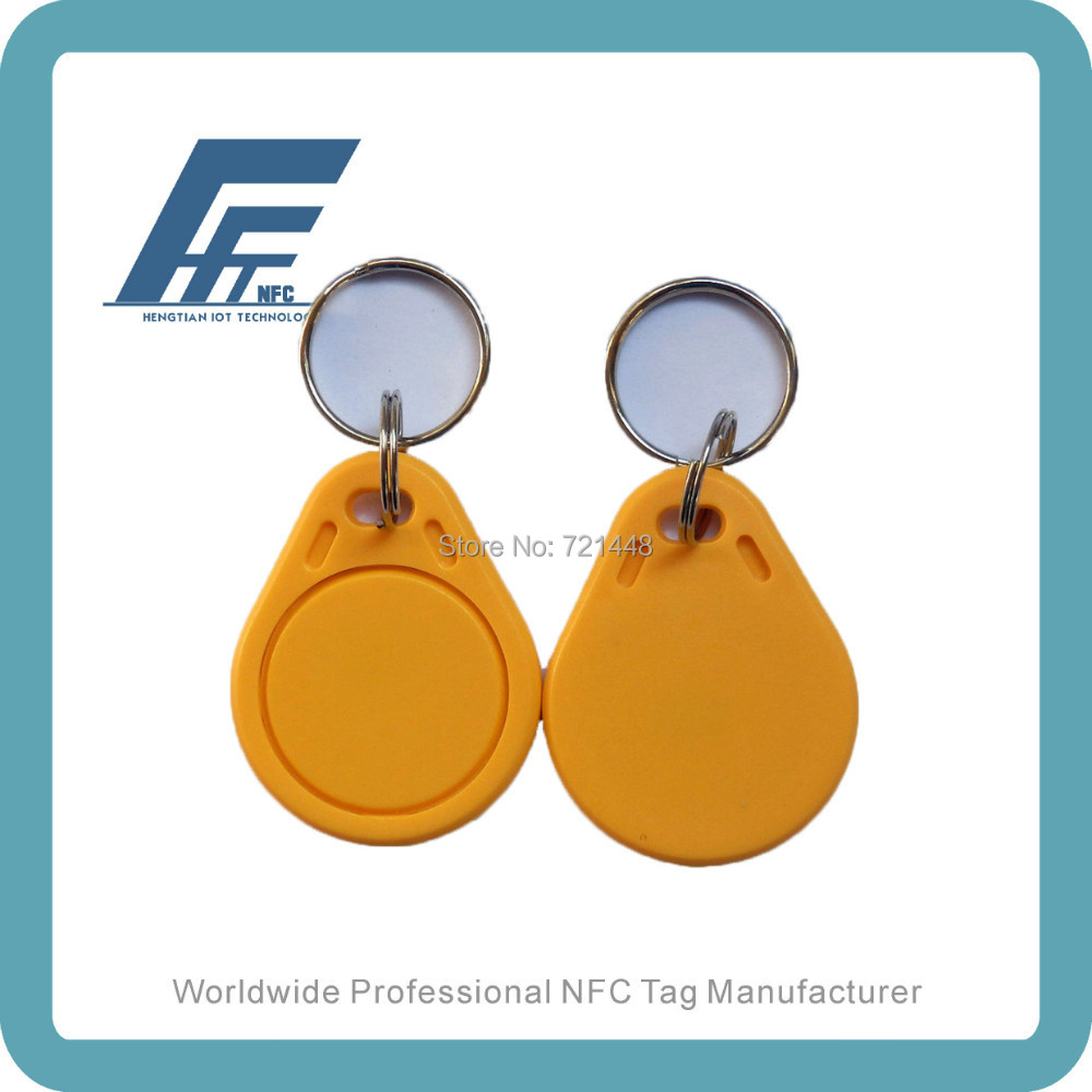 100pcs RFID keyfob tags 13.56MHz Yellow Key fob Available For All NFC Phone Ntag213 NFC Keyfobs 100pcs nfc keyfobs purple keychain available for all nfc phone ntag213 waterproof factory price