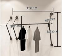 clothing store display rack. Wall hangers. Hangers on the walls. Metal racks for men and women's fashion shops. Clothes rack.059
