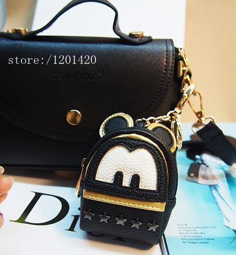 Nueva negro mujeres mini karl monster mochila bolsa bolsa de insectos encanto llavero llavero teléfono decoración pompón de piel Genuina cuero