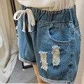 2016 Novo estilo verão shorts mulheres plus size boyfriend lavado Soltas shorts jeans rasgado buraco jeans curto mulher