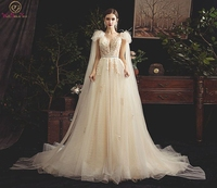 Wedding Dress 2019 New Flowing Long Sleeves Backless Lace up Tulle Boat Neck Sweep Train Appliques Beading Feathers Bridal Gown