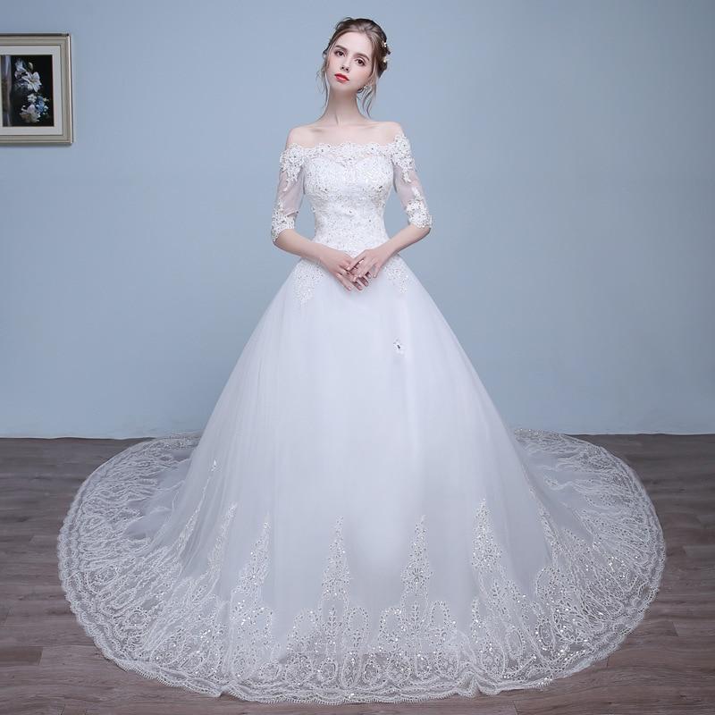 Vivian Wedding Gown: Vivian's Bridal Off Shoulder Illusion Half Sleeve Bridal