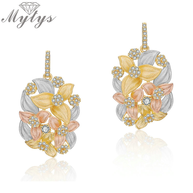 Mytys Tricolor Gold Sandblasting Earrings Flower Embrace Dangle Drop Ear Jewelry Three Gold Fashion Statement Earrings CE451 золотые серьги по уху