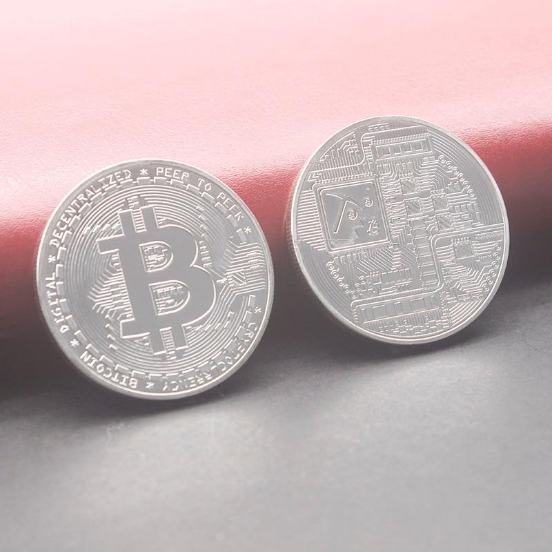 silver color bitcoin coin