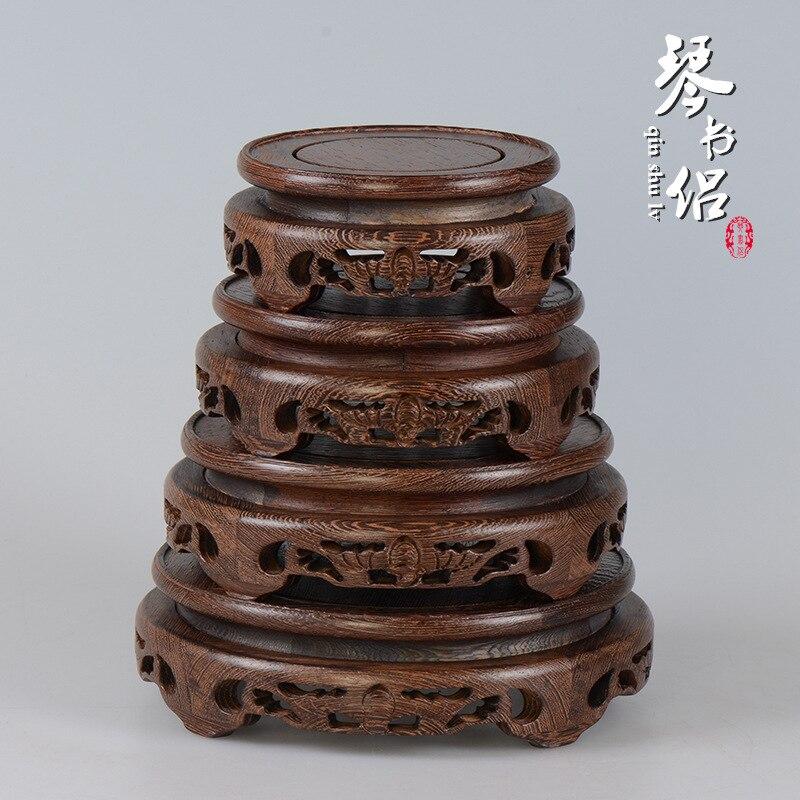 Sculpture sur bois ailes de chauve-souris en bois base circulaire ornements socle en acajou base étagère vase théière bonsaï