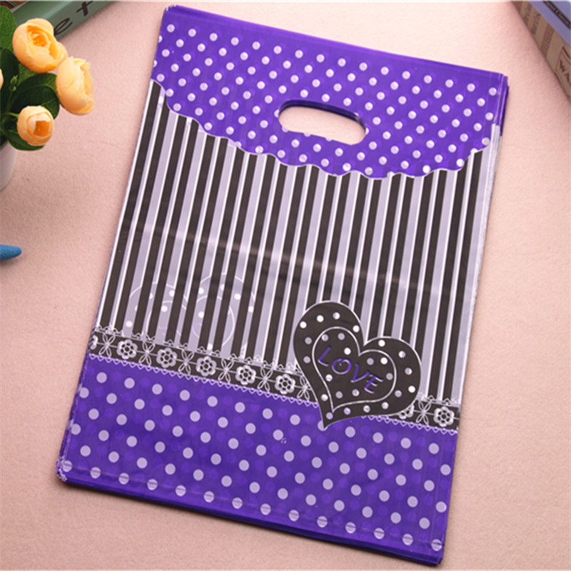 2017 New Design Wholesale 100pcs/lot 30*40cm Luxury Purple Shopping Bags With Love Heart Plastic Clothing Packaging Bags
