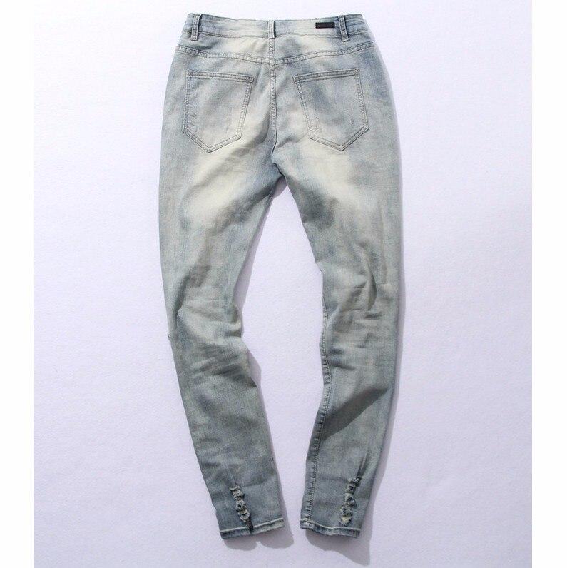 Hip Hop moda Cool hombres ropa urbana mono cremallera roto rock star jeans  con algunos agujeros rotos en Pantalones casuales de La ropa de los hombres  en ... 0b9b8e7fe16