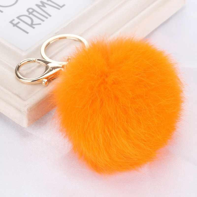 8 ซม.น่ารักสีม่วงมิ้นท์สีเขียวสีชมพูของแท้หนังกระต่าย fur ball พวงกุญแจกุญแจกระเป๋ารถจี้ fur pom pom keychain