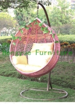 Brown wicker swing hanging chair with cushions