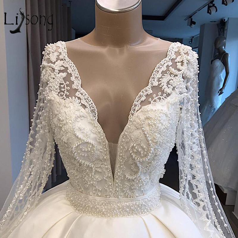 Luxury Beaded Pearls Wedding Dresses With See Thru Long Sleeves Sexy Backless Bridal Gowns Lace Wedding Gowns Robe De Mariee