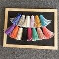 2 unids/lote Corea PU de la borla de Cuero Del Coche Llavero colgante mujeres diy Accesorios encanto de la borla del bolso de cuero