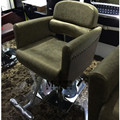New luxury european-style chair. Hair salons dedicated hairdressing chair. Haircut chair. Barber's chair