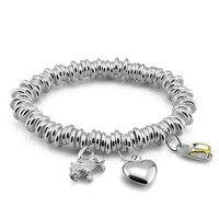 British fashion style silver bracelet.Woman solid 925 silver heart shaped pendant bracelet.Individuality stretch bracelets.