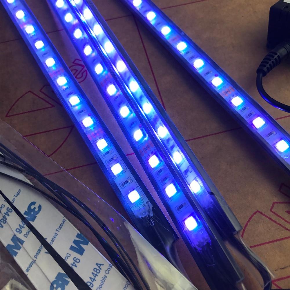 https://ae01.alicdn.com/kf/HTB1Fud0RVXXXXXuXpXXq6xXFXXXY/Auto-RGB-LED-Strip-Licht-Muziek-Controle-LED-Strip-verlichting-7-Kleuren-Auto-Styling-Sfeer-Lampen.jpg