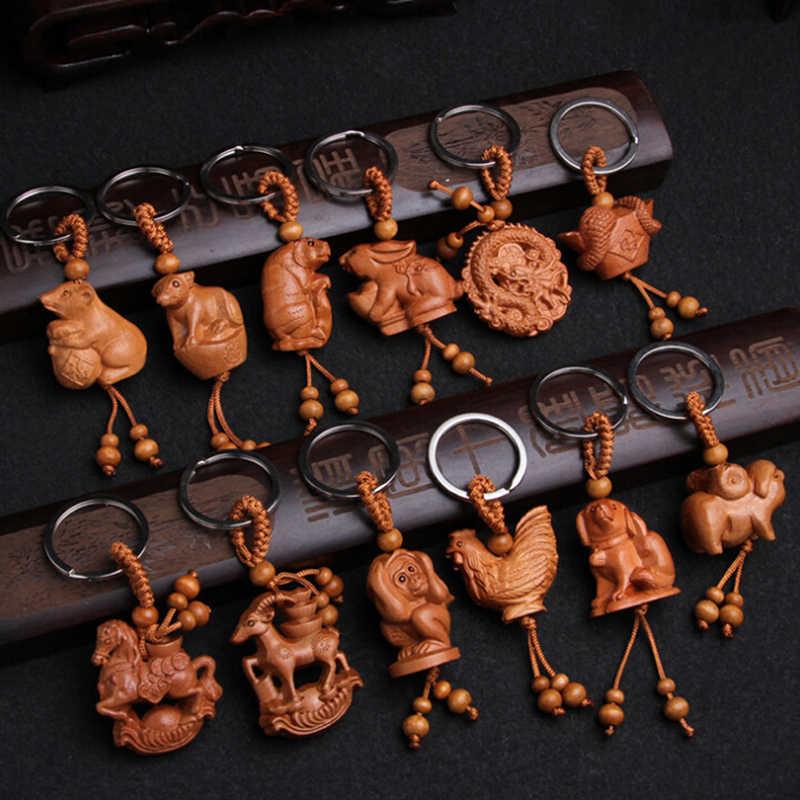 موضة للجنسين الأطفال الحيوان قرد الأغنام ثعبان التنين النمر حلقات المفاتيح الخشب الطبيعي 12 زودياك حلقات المفاتيح
