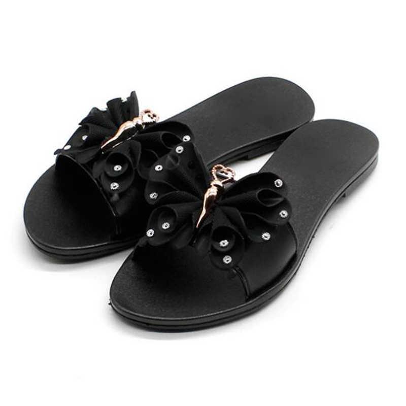 ... COVOYYAR Lovely Bow Women Slides Black Home Outside Flat Beach Shoes  Summer Rhinestone Plastic Jelly Slippers ... 667beaa69bb8