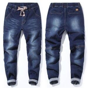 Image 2 - 2018 jesień nowe męskie Plus Size dżinsy moda Casual Hip Hop luźny dżins dżinsy czarne niebieskie spodnie Harem spodnie 5XL 6XL 7XL