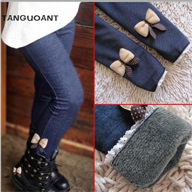 New 2018 girls bow jeans cotton children cashmere pants kids warm elastic waist legging wholesale and retail afs jeep wholesale price original brand winter spring thickness cashmere inner gray man s denim jeans mid waist water washing