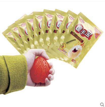 10 + 1 piezas Almohadillas térmicas de mano Warm Keeper Patch Wrap Etiqueta de cuidado de manos y un huevo Paquete de autocalentamiento de invierno Mensaje Relajación