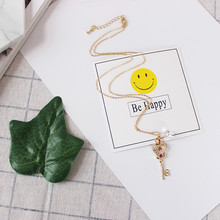 Free shipping fashion woman new jewelry Exquisite time and space key hollow synthetic gemstone chain Accessories girl
