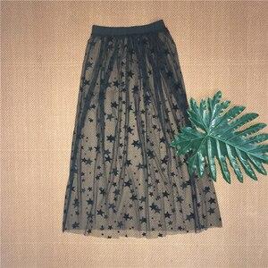 Image 3 - Herfst Winter Vrouwen Mesh Hollow Out Rokken Fashion Casual Elegant Lace Transparante Rok Sterren Overrok Midi EEN Lijn lange Rok