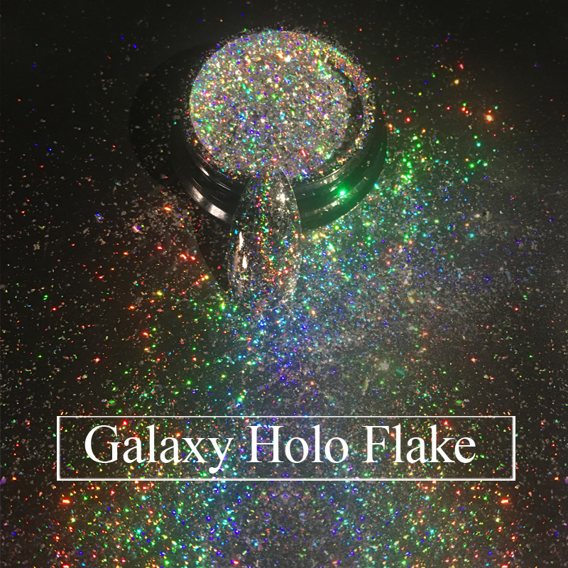 Жоғарғы сыныптағы Galaxy Holo флэштері 0.2g / box Laser Bling Rainbow Flecks Chrome Магия әсері Irregular Nail Art Glitter Powder