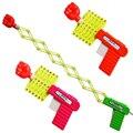 2 pçs/lote Gags Piadas Engraçadas elástico telescópica punho arma brinquedos para as crianças DIY manual de brinquedo crianças brinquedos