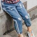 2017 Весной и осенью новая девушка джинсы Корейских детей в детских отверстия джинсовые брюки бесплатная доставка